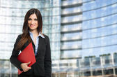 Business woman holding folder — Stock Photo