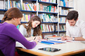 Students in a library — Stock Photo