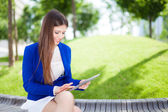 Woman using a digital tablet — Stock Photo