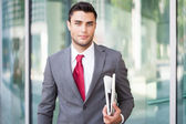Business man holding a newspaper — Stock Photo