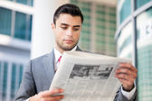 Business man reading a newspaper — Stock Photo