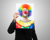 Man holding a clown face — Stock Photo