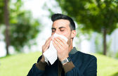 Man blowing his nose — Stock Photo