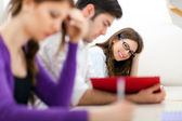 Students studying in library — Stock Photo