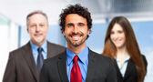 Smiling handsome businessman — Stock Photo
