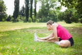 Woman stretching her leg — Stock Photo