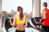 People training on treadmills — Stok fotoğraf