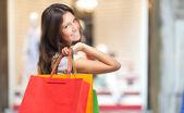 Woman holding shopping bags — Foto Stock
