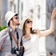 Tourists couple in the city — Stock Photo #48477561