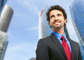 Handsome confident young businessman — Stock Photo