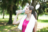 Active woman drinking water — Stock Photo