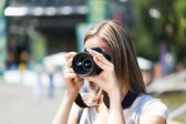 Photographer using a camera — Stock Photo