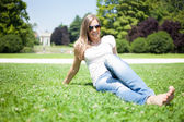 Woman sunbathing in a park — Stock Photo