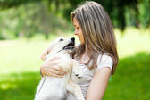 Girl with her dog outdoors — Stock Photo