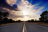 Asphalt road and sunset sky — Stock Photo