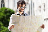 Tourist looking at a map — Stock Photo