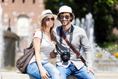 Tourists sitting near fountain — Stock Photo
