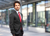 Handsome businessman in urban setting — Stock Photo