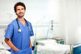 Handsome doctor in ward — Stock Photo
