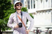 Tourist holding a digital camera — Stock Photo