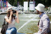 Woman taking a picture of her boyfriend — Stock Photo