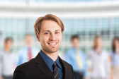 Businessman in front of his team — Foto Stock