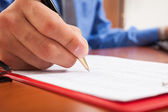 Man writing on document — Stock Photo