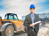 Architect at work in construction site — Stock Photo