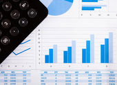 Calculator and financial charts — Foto Stock