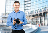 Photographer using his camera — Stock Photo