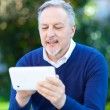 Mature man using tablet — Stock Photo #50348375