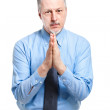 Businessman in begging gesture — Stock Photo #50348395