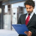 Businessman holding clipboard — Stock Photo #50348907