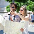 Couple of tourists reading map — Stock Photo #50349127