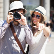 Tourists walking in city — Stock Photo #50349401