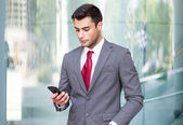 Business man using cell phone — Stock Photo