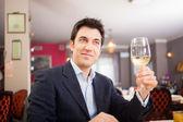 Man holding glass of wine — Stock Photo