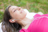 Relaxed woman listening music — Stock Photo