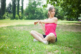 Woman stretching her arms — Stock Photo