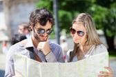 Couple of tourists reading map — Stock Photo