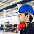 Portrait of a worker in factory — Stock Photo