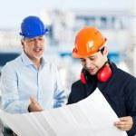 Engineer explaining drawing — Stock Photo