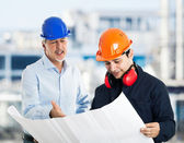 Engineer explaining drawing — Stock Photo