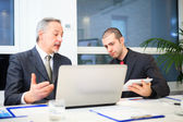 Business people at work in office — Stock Photo