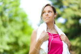 Woman refreshing after running — Stock Photo