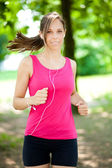 Woman jogging at the park — Stock Photo