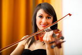 Woman playing her violin — Stock Photo