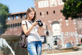 Woman using camera — Stock Photo