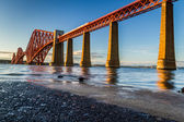 Train riding on the Forth Road Bridge at sunset — Stock Photo