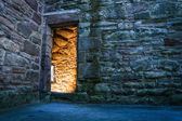 Lighted dorway to the ancient castle — Stock Photo